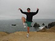 Monica acting weird on a rock           above the Pacific